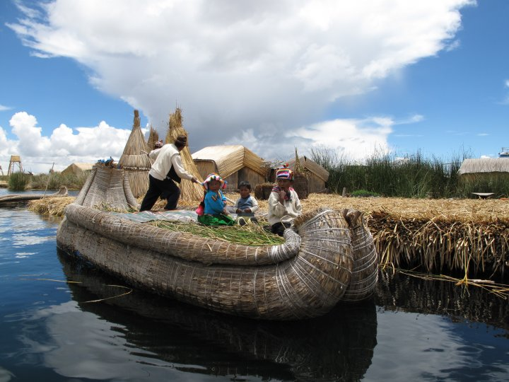 Family on boat in Lake Titicaca